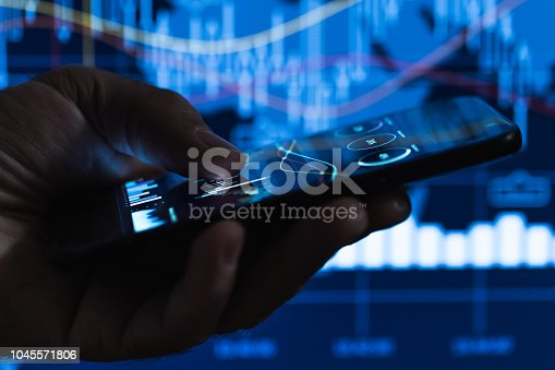 Businessman alalysing stock market graph