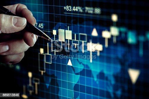 Businessman alalysing stock market graph