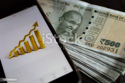 istock Stock market prices gone up. Mobile app for stock market. Stock prices rise. Profit and cash. 1063988550