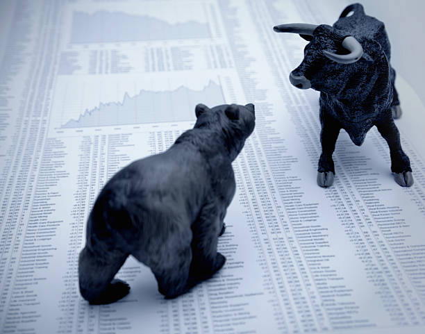 Stock market report with bull and bear  and stock pictures, royalty-free photos & images