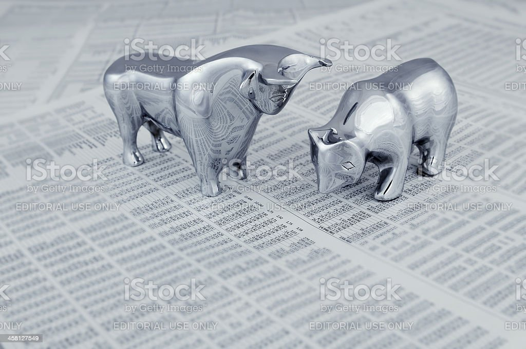 Stock market report with bull and bear stock photo
