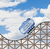 A rollercoaster car represented by a stock certificate medallion rides on the volatile tracks of a rollercoaster.