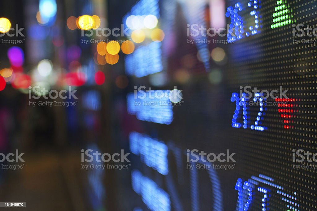 Stock market screen fading into blur royalty-free stock photo