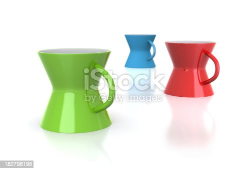 Colourful mugs on white with reflection Defocused imaj