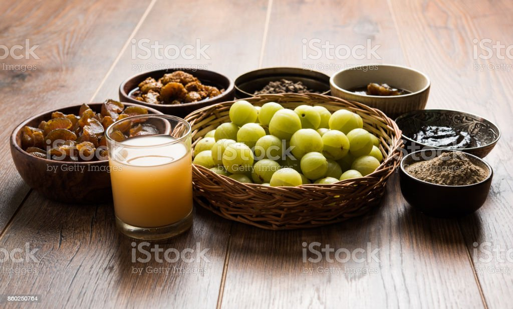 Stock photo of Amla/Avla/Aavla and it's by products like chyawanprash or chyavanprash, juice, Amla supari or mouth freshner, powder, juicy or dried sweet murabba or muramba, pickle, selective focus stock photo