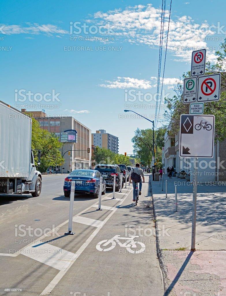 Stock Photo of Downtown Saskatoon Protected Bike Lane With Cyclist stock photo