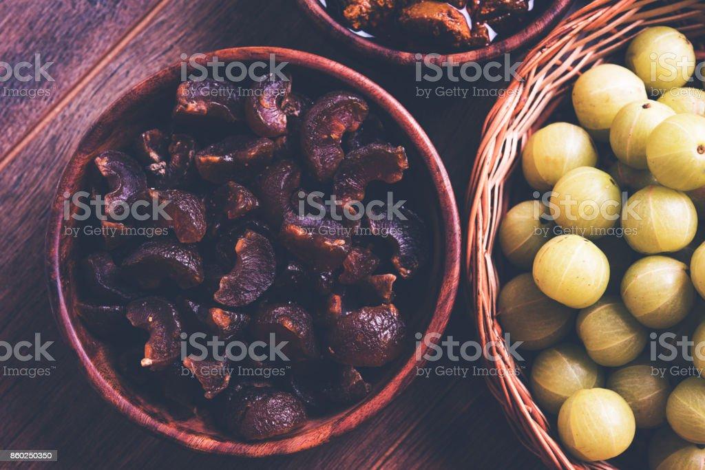 Stock photo of dried sweet and salty or chatpata Amla/Avla/Aavla called murabba, muramba or candy, selective focus stock photo