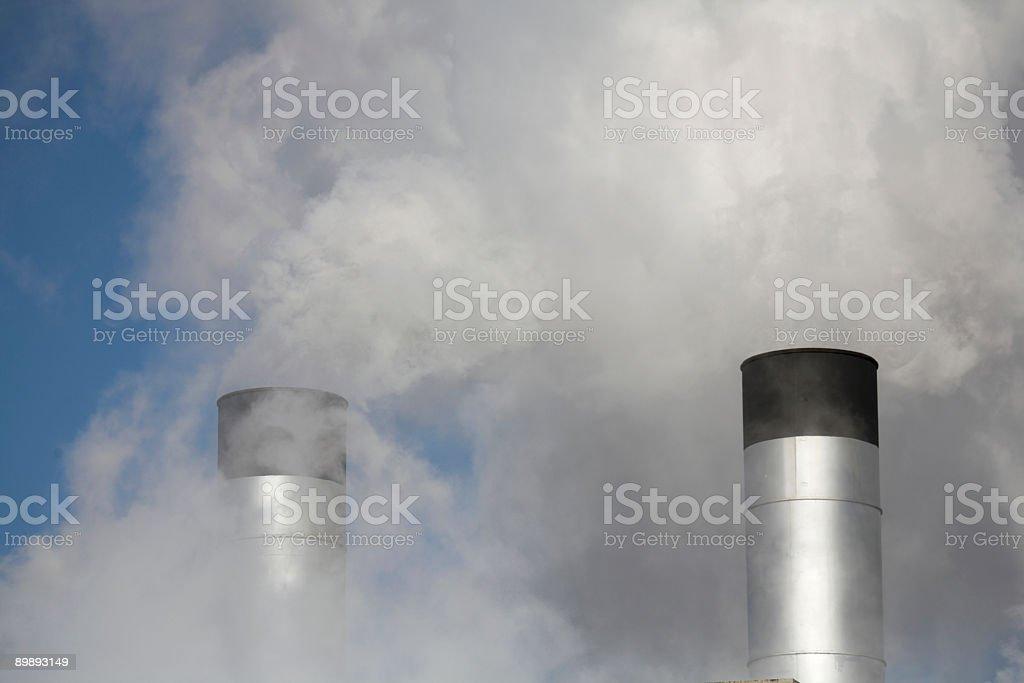 Stock Photo of Two Smokestacks with smog royalty-free stock photo