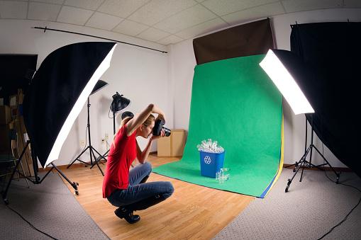 Stock Photographer Taking Studio Photos Stock Photo - Download Image Now