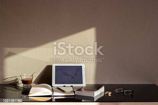 stock trader workplace with financial market graphs on laptop and copy space. investor concept,