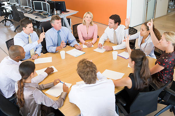 Stock Traders In A Meeting Stock Traders In A Meeting Working Hard staff meeting stock pictures, royalty-free photos & images