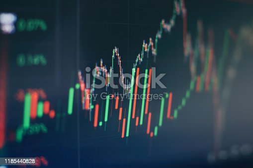 896567272istockphoto Stock trading, crypto currency background.The business plan at the meeting and analyze financial numbers to view the performance of the company. 1185440828