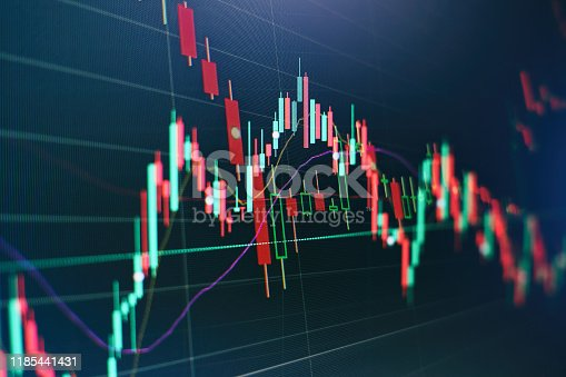 896567272istockphoto Stock trading, crypto currency background.The business plan at the meeting and analyze financial numbers to view the performance of the company. 1185441431