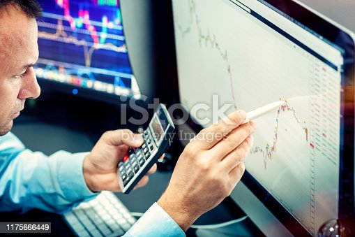 Stockbroker analyzes the financial chart. Online stock exchange on a computer monitor.