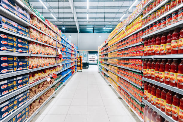 Stocked Supermarket Stocked supermarket ready for business grocery aisle stock pictures, royalty-free photos & images