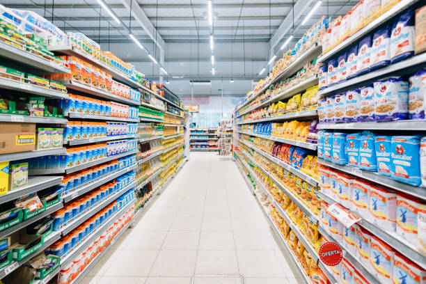 Stocked Supermarket Stocked supermarket ready for business aisle stock pictures, royalty-free photos & images