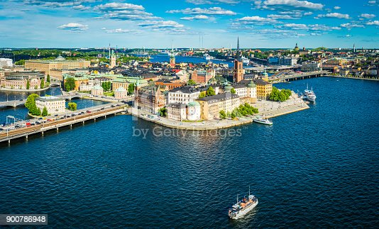 Panoramic aerial view over the blue summer skies above the iconic waterfront of Gamla Stan and Sodermalm in the heart of Stockholm, Sweden's vibrant capital city.