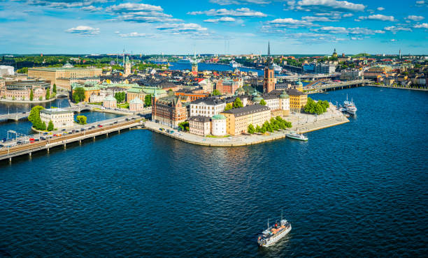 Stockholm aerial panorama over Gamla Stan city waterfront landmarks Sweden Panoramic aerial view over the blue summer skies above the iconic waterfront of Gamla Stan and Sodermalm in the heart of Stockholm, Sweden's vibrant capital city. stockholm stock pictures, royalty-free photos & images