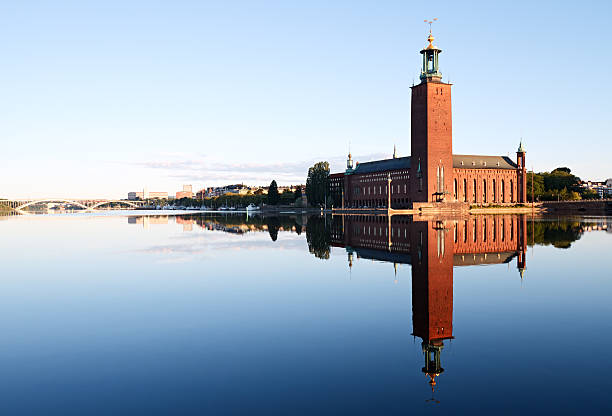 Stockholm City Hall with reflection on water stock photo