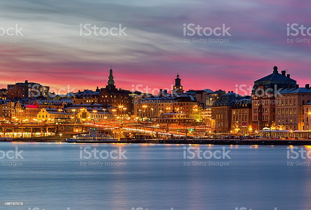 Stockholm city night image with pink sunset. stock photo