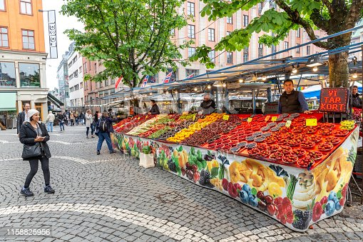 June 13, 2019. Stockholm. Outside market of fruits and flowers in Stockholm, Sweden. People buy or walk by the street.