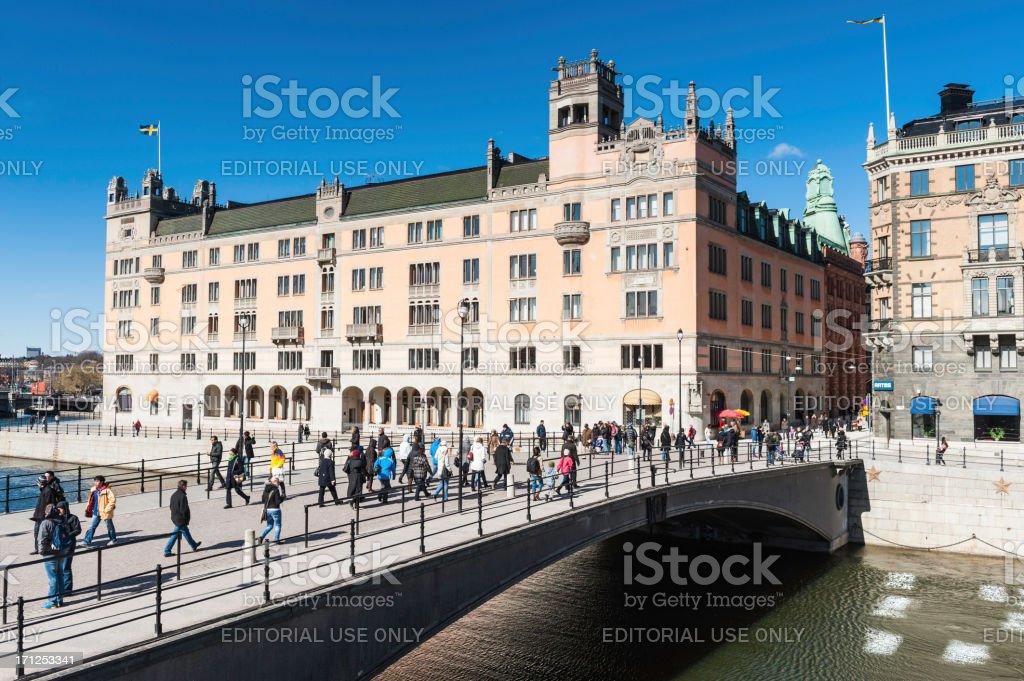 Stockholm crowds on Riksbron bridge beside Rosenbad stock photo