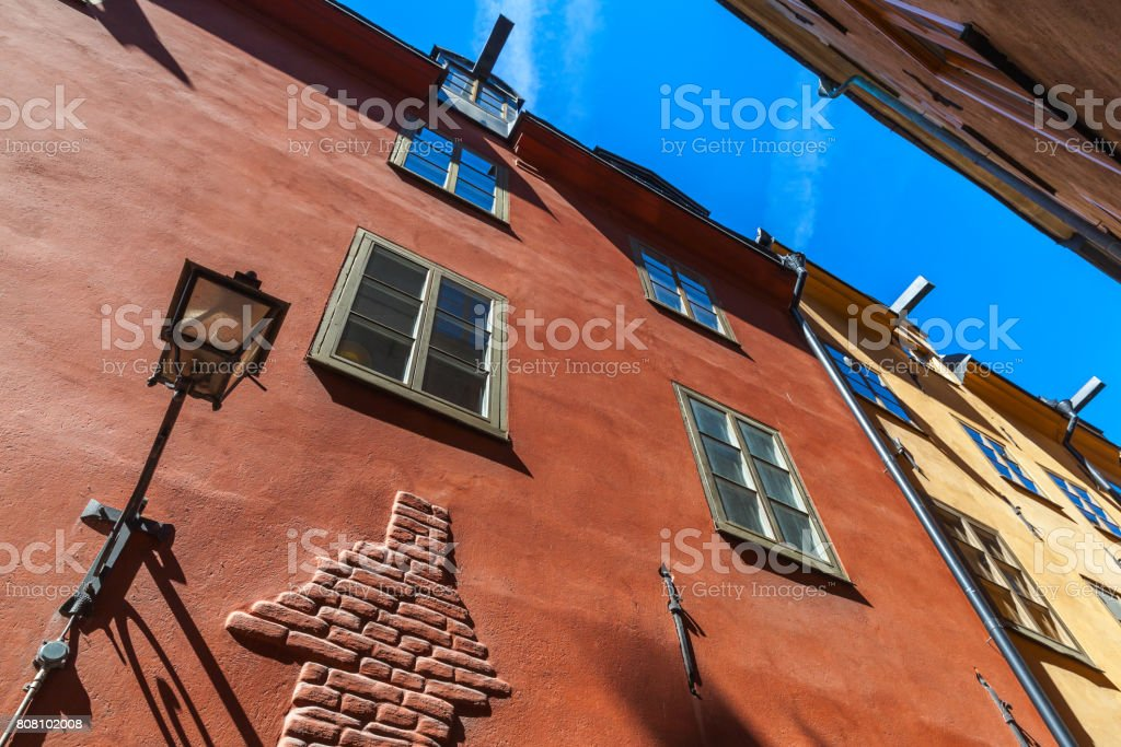 Stockholm. Old red house facade with street lamp stock photo