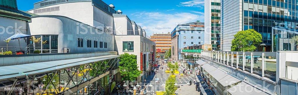 Stockholm pedestrians enjoying summer sunshine shopping street Hotorget panorama Sweden stock photo