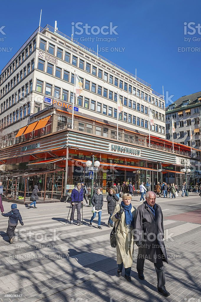 Stockholm people crossing Kungsgatan to Hotorget Sweden stock photo