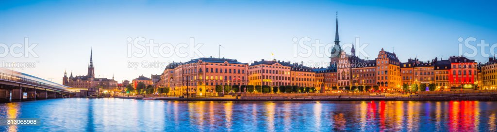 Stockholm spires of Gamla Stan illuminated at dusk panorama Sweden stock photo