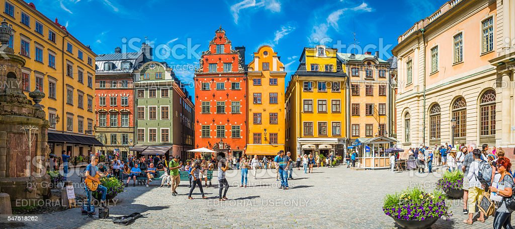 Stockholm Stortorget tourists in medieval square colourful houses restaurants Sweden stock photo
