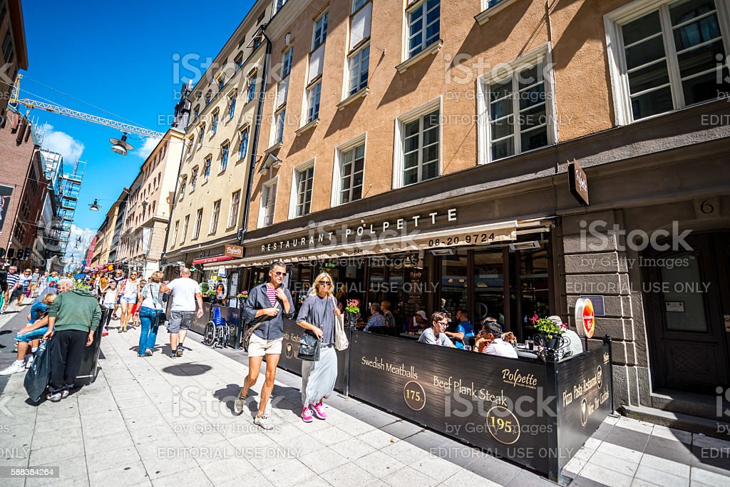 Stockholm street with cafe and tourists, Sweden stock photo
