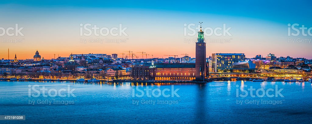 Stockholm sunset cityscape panorama over harbour City Hall waterfront Sweden stock photo
