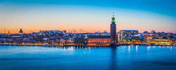stockholm sunset cityscape panorama over harbour city hall waterfront sweden - skyline stockholm bildbanksfoton och bilder