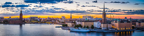 stockholm sunset spires city hall illuminated waterfront cityscape panorama sweden - skyline stockholm bildbanksfoton och bilder