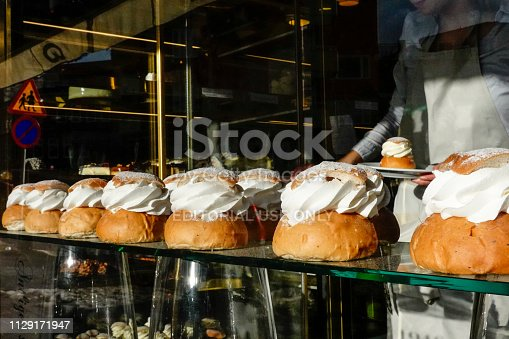 Stockholm, Sweden February 12, 2019 A sweet national delicacy known as the semla, semlor in the plural, in the window of a bakery in Grondal.