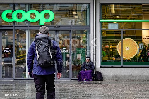 Stockholm, Sweden March 10, 2019  A Romanian beggar sits outside a COOP grocery store.