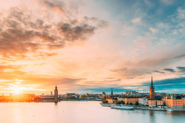 Stockholm, Sweden. Scenic Famous View Of Embankment In Old Town Of Stockholm At Summer. Gamla Stan In Summer Evening. Famous Popular Destination Scenic Place And UNESCO World Heritage Site stock photo