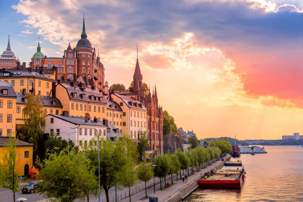 Stockholm, Sweden. Scenic summer sunset view with colorful sky of the Old Town architecture in Sodermalm district. Stockholm, Sweden. Scenic summer sunset view with colorful sky of the Old Town architecture in Sodermalm district stockholm stock pictures, royalty-free photos & images