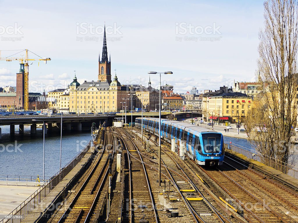Stockholm Sweden. Subway train appraoching Slussen. Old city in background. stock photo