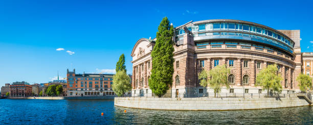 Stockholm Swedish Parliament building Riksdagshuset overlooking blue harbour waterfront Sweden stock photo