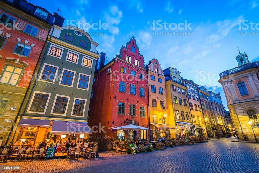 Stockholm tourists enjoying colourful Stortorget bars restaurants at sunset Sweden bildbanksfoto