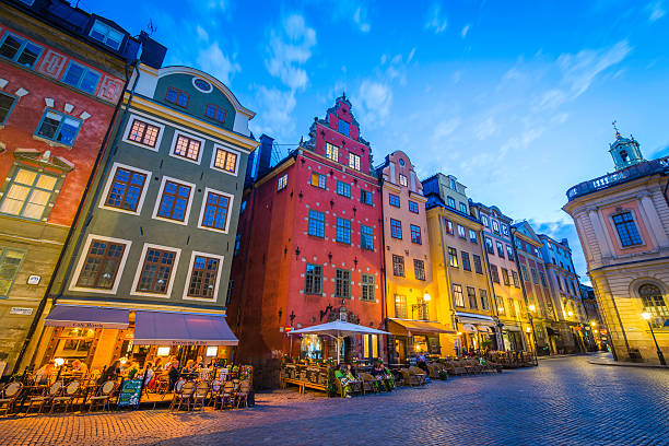 stockholm tourists enjoying colourful stortorget bars restaurants at sunset sweden - stockholm bildbanksfoton och bilder
