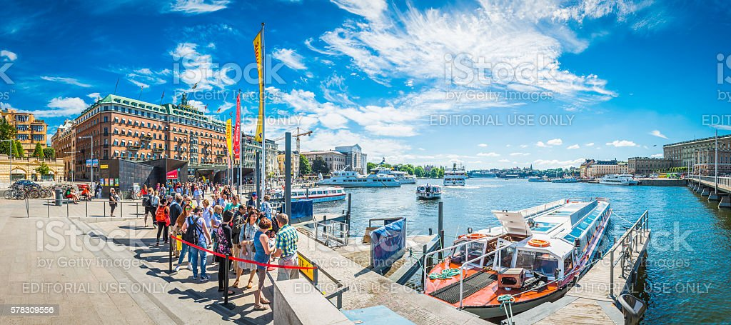 Stockholm tourists waiting for ferry on harbour waterfront panorama Sweden stock photo