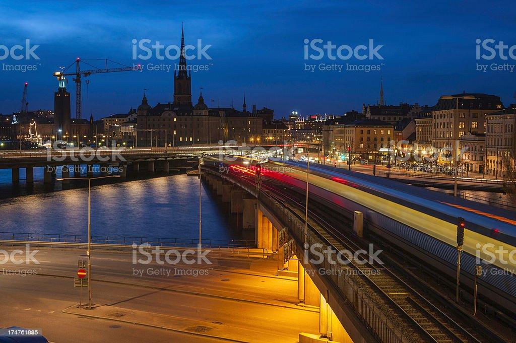 Stockholm train zooming through Slussen towards city Sweden royalty-free stock photo