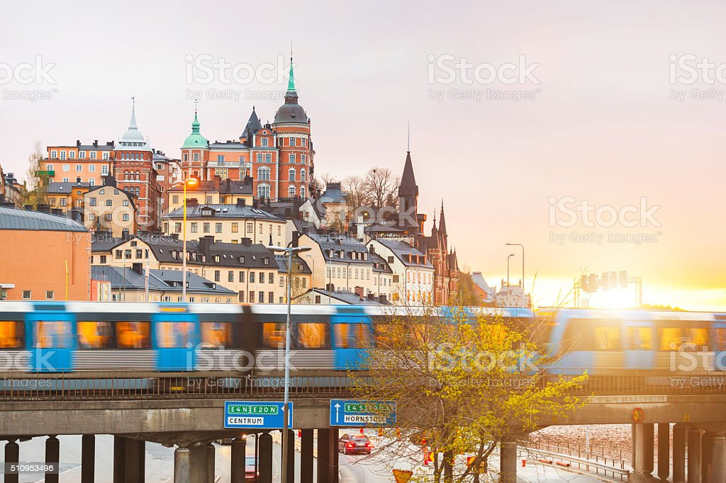 Stockholm, view of buildings and train at dusk stock photo