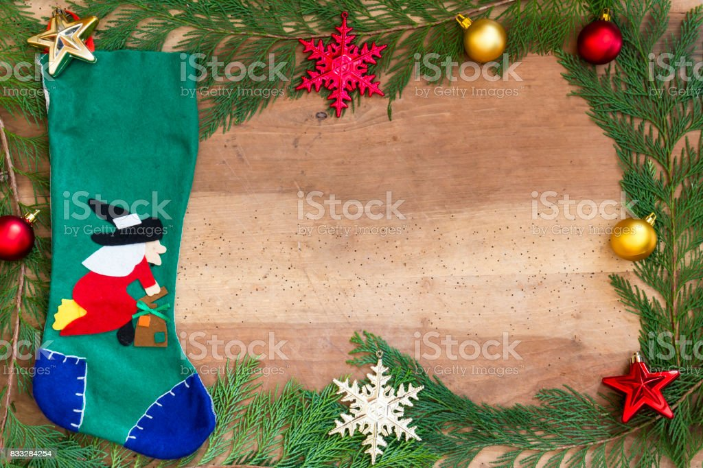 Stocking Befana and Christmas decorations on wooden background - foto stock