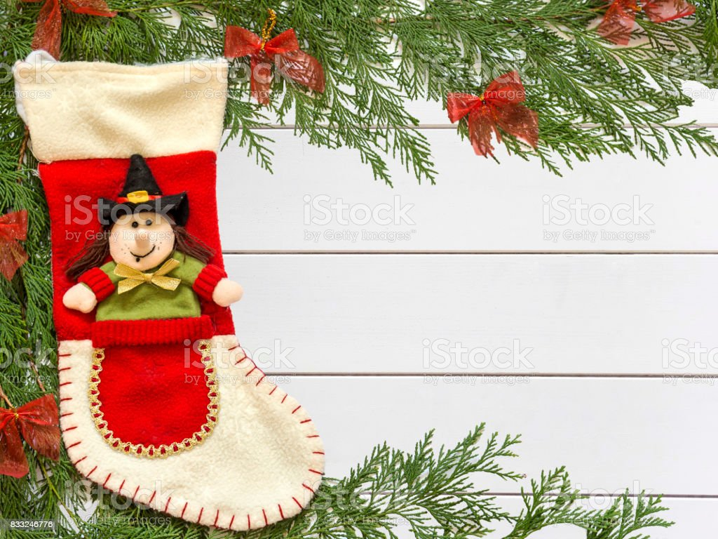 Stocking Befana and Christmas decorations on wooden white background - foto stock