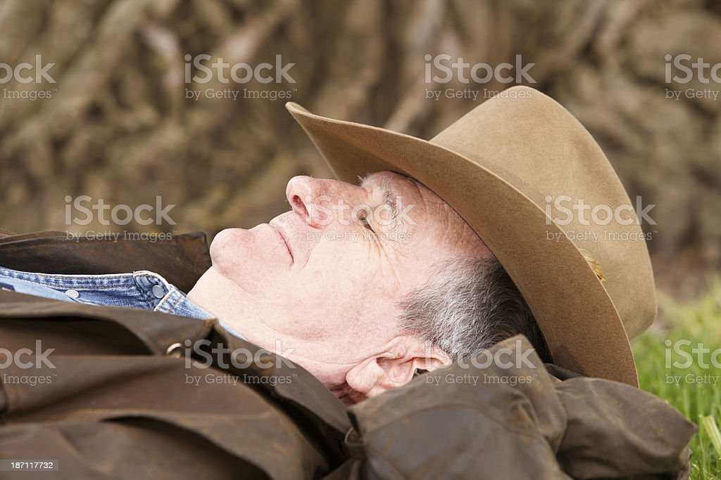 Stockman taking a nap in his bush hat stock photo