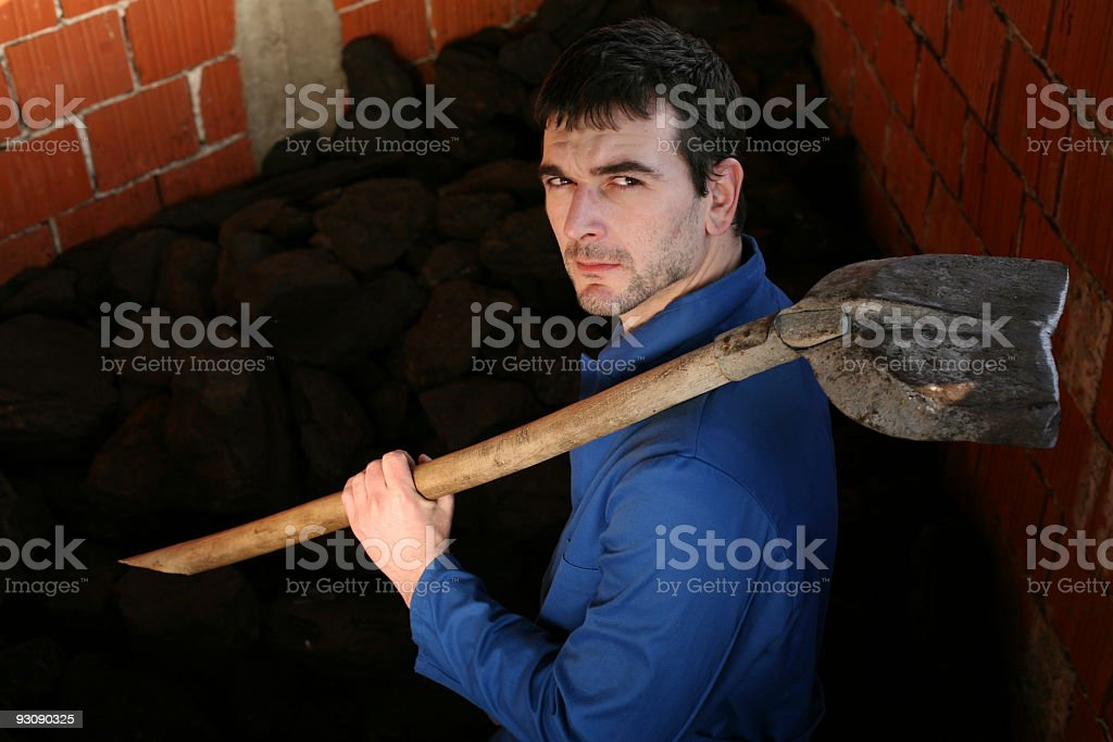 Stoker with shovel royalty-free stock photo